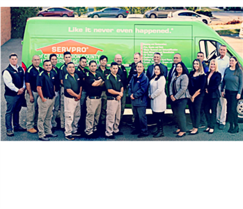 Photo of the entire team in front of our SERVPRO van.